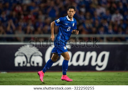 BANGKOK,THAILAND SEPTEMBER 08:Pokklaw Anan  of Thailand in action during the 2018 FIFA World Cup Qualifier between Thailand and Iraq at Rajamangala Stadium on Sep 8, 2015 in Thailand. - stock photo
