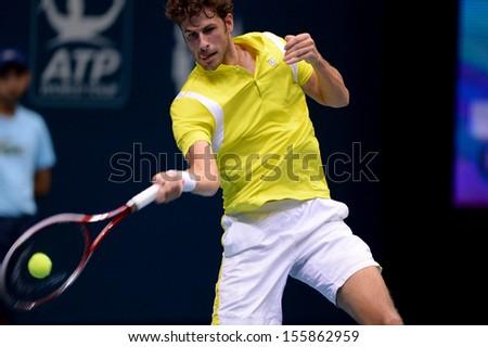 BANGKOK,THAILAND-SEPTEMBER 23:Robin Haase(NED) returns during match against Daniel GIMENO-TRAVER(ESP)at Thailand Open on September23, 2013 at Impact Arena Muang Thong Thani, Bangkok, Thailand  - stock photo