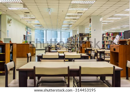 BANGKOK, THAILAND - 10 SEPTEMBER : Row of bookshelves in a public library of Chulalongkorn University on September 10, 2014.  - stock photo