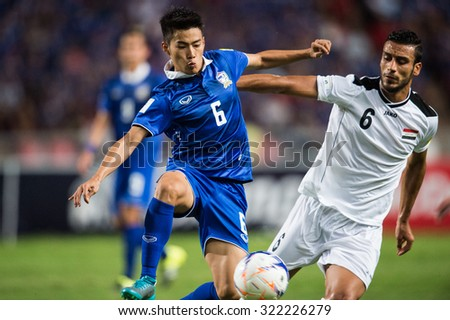 BANGKOK,THAILAND SEPTEMBER 08:Sarach Yooyen (blue) of Thailand in action during the 2018 FIFA World Cup Qualifier between Thailand and Iraq at Rajamangala Stadium on Sep 8, 2015 in Thailand. - stock photo