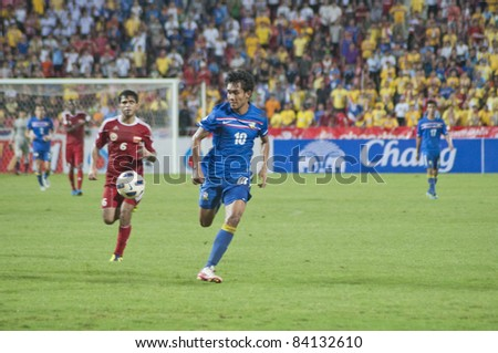 BANGKOK THAILAND - SEPTEMBER 6 : T.Dangda (B) in action during FIFA WORLD CUP 2014 (Round 3), between Thailand vs Oman on September 6, 2011 in Rajamangla Stadium,Bangkok, Thailand.