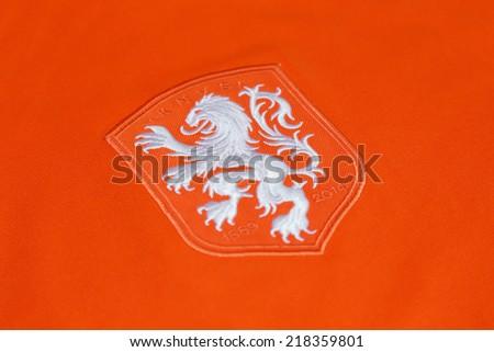 BANGKOK, THAILAND - SEPTEMBER 11, 2014: The Netherlands football Logo from Netherlands  National Football official  jersey on 11September 2014 in Bangkok Thailand. - stock photo