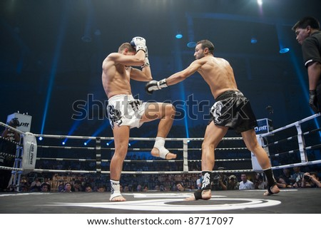 BANGKOK, THAILAND- SEPTEMBER 25 : Unidentified boxers compete in Thai Fight : Muay Thai, World's Unrivaled Fight on September 25, 2011 at Thammasat University Convention Center in Bangkok, Thailand