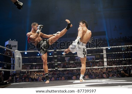 BANGKOK, THAILAND- SEPTEMBER 25 : Unidentified boxers compete in Thai Fight:Muay Thai World's Unrivaled Fight on September 25, 2011 at Thammasat University Convention Center in Bangkok, Thailand - stock photo