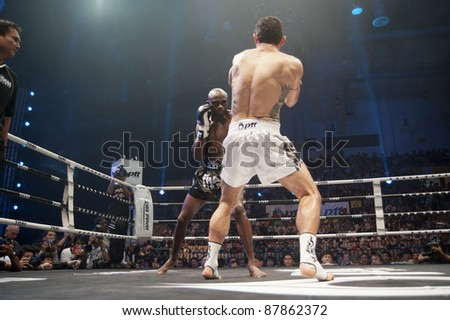 BANGKOK, THAILAND- SEPTEMBER 25 : Unidentified boxers compete in Thai Fight:Muay Thai. World's Unrivalled Fight on September 25, 2011 at Thammasat University Convention Center, Bangkok, Thailand - stock photo