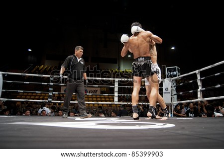 BANGKOK THAILAND- SEPTEMBER 25 : Unidentified players in Thai Fight : Muay Thai..World's Unrivalled Fight on September 25, 2011 at Thammasat University Cnvention Center,Bangkok Thailand