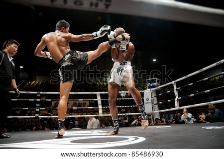 BANGKOK, THAILAND- SEPTEMBER 25 : Unidentified players in Thai Fight:Muay Thai. World's Unrivalled Fight on September 25, 2011 at Thammasat University Convention Center, Bangkok, Thailand - stock photo