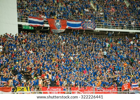 BANGKOK,THAILAND SEPTEMBER 08:Views unidentified Thai fans cheer their team during the 2018 FIFA World Cup Qualifier between Thailand and Iraq at Rajamangala Stadium on Sep 8, 2015 in Thailand. - stock photo