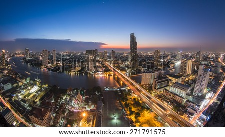 Bangkok Transportation at Dusk with Modern Business Building along the river (Thailand)