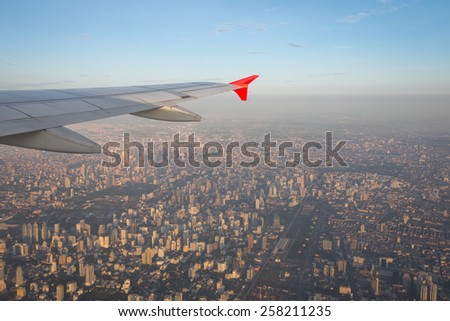 Bangkok view and city building from plane windows - stock photo