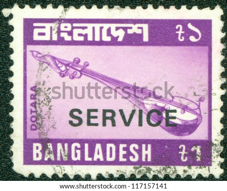 BANGLADESH - CIRCA 1974: A stamp printed in BANGLADESH shows Musical instruments, circa 1974 - stock photo