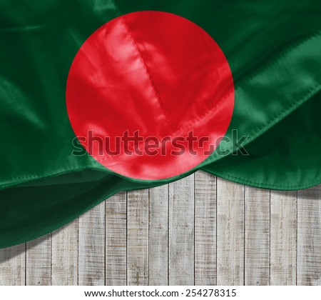Bangladesh flag and wood background - stock photo