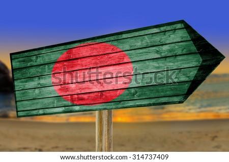 Bangladesh Flag wooden sign on beach background - stock photo