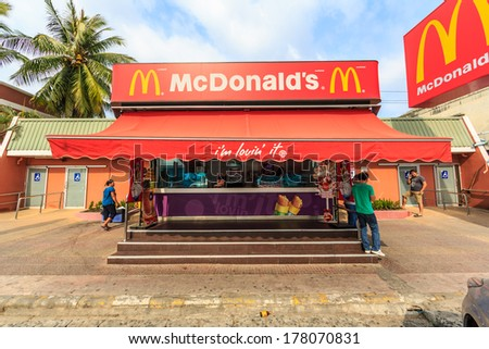 BANGPRAKONG, THAILAND - FEB 8: McDonald's front store at motor way rest area on Feb 8, 13 in Bangprakong. It is the world's largest chain of hamburger fast food restaurants. - stock photo
