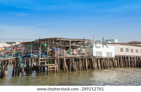 BANGSARAE,THAILAND - JUNE 20: The house building and wooden bridge in fisherman village on June 20, 2015 in Bangsarae, Thailand.