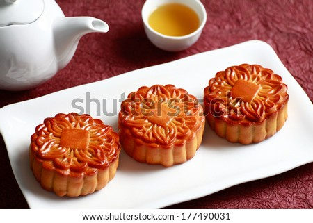 BANH TRUNG THU (Vietnamese language) - Mooncakes with a tea pot and tea c tea,Chinese mid autumn festival food. - stock photo