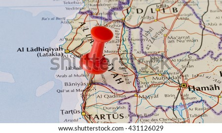 Baniyas marked on map with red pushpin. Selective focus on the word Baniyas and the pushpin. Pin is in an angle. Midground is sharp while foreground and background is blurry. - stock photo