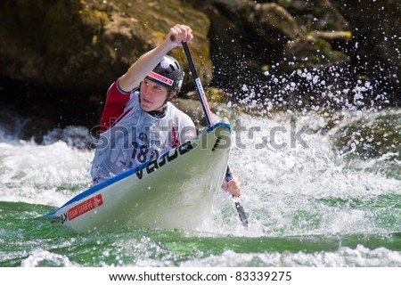 BANJA LUKA, BOSNIA AND HERZEGOVINA - JULY 16: An unidentified athlete from Switzerland competes at European Junior and U23 Canoe Slalom Championships on July 16, 2011, Banja Luka, Bosnia/Herzegovina.