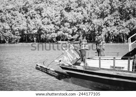BANJUL, GAMBIA - MAR 14, 2013: Unidentified Gambian fisher men on a boat in Gambia, Mar 14, 2013. Major ethnic group in Gambia is the Mandinka - 42%