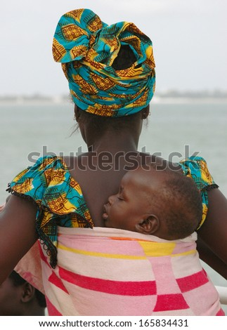 BANJUL, GAMBIA - SEPTEMBER 12: Portrait of unidentified Mandinka child with mother on Sept 12, 2005 in Banjul, Gambia. The major ethnic group in Gambia is the Mandinka - 42% of the total population. - stock photo