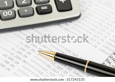 Bank account passbook with pen and calculator