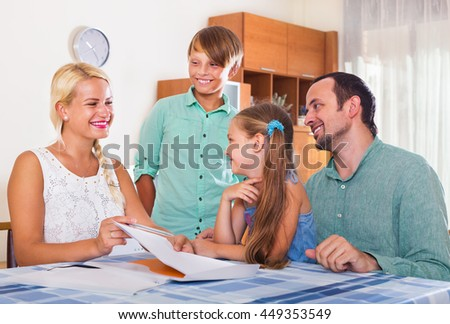Bank agent consulting family with kids at home interior