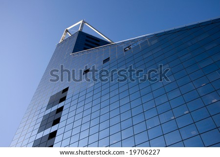 Bank building and blue sky view from down - stock photo
