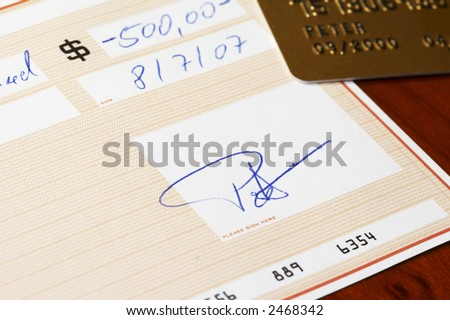 bank check, gold credit card in background - stock photo