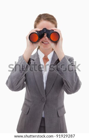 Bank employee looking through spyglasses against a white background - stock photo