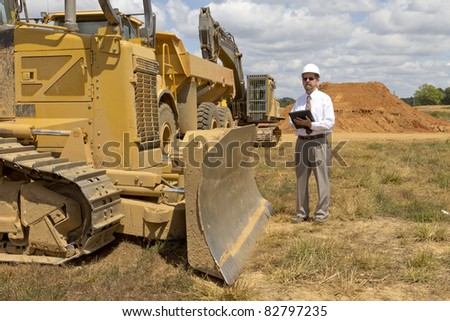 Bank finance personal inspecting location for new factory that his company financed