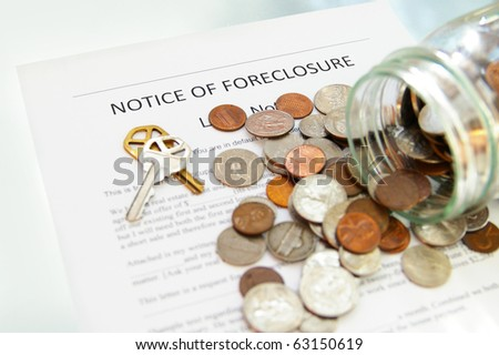 bank foreclosure notice and spilled coin jar