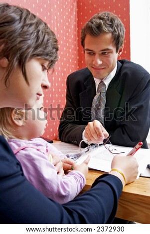 Bank manager with mother and her child  wanting a loan
