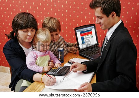 Bank manager with mother and her two children wanting a loan - stock photo