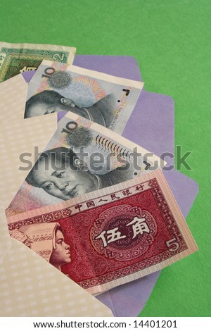 Bank notes in envelopes in green background - stock photo