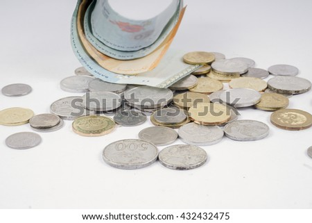 Bank notes in the glass and coins  isolated on white. Business concept. DOF and copy space.