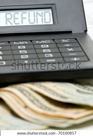 Bank notes with calculator - tax refund concept - stock photo