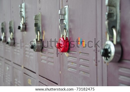 Bank of school lockers with combination locks. - stock photo