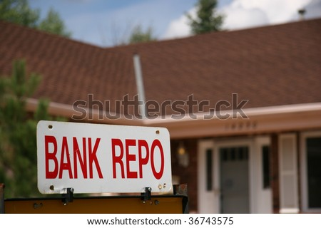 Bank Repo Sign on Home For Sale - stock photo