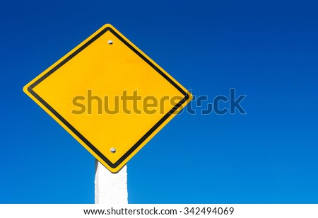 bank road sign against blue sky - stock photo