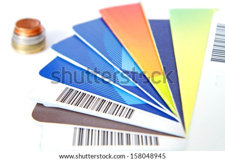 Bank saving account passbook with lot of coins - stock photo