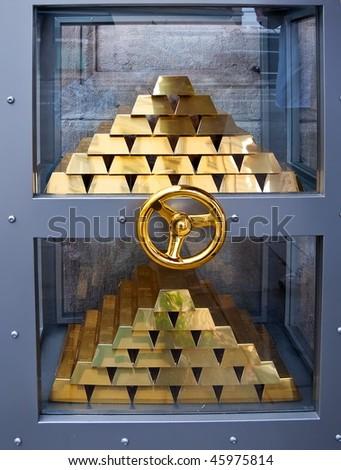 Bank vault with stack of gold bars in Geneva, Switzerland - stock photo