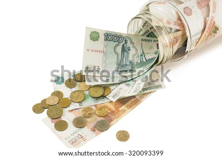 Bank with money, dollars , euros and scattered coins on a white background