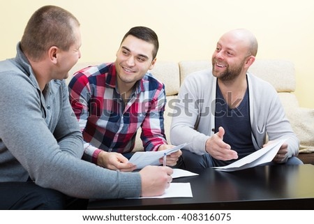 Banking agent explaining happy adults terms of contract indoor