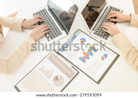 Banking business or financial analytics desktop with accounting charts - stock photo