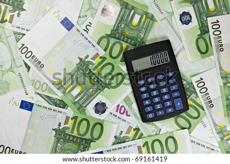 banking concept . black calculator and euro currency