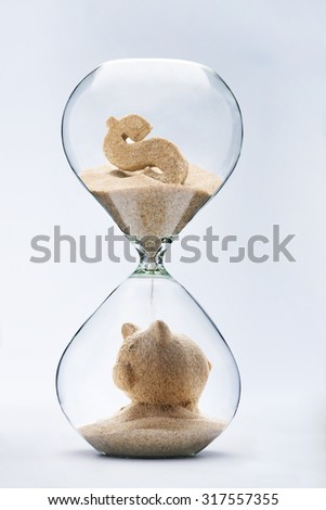 Banking concept. Piggy bank made out of falling sand from dollar sign flowing through hourglass - stock photo
