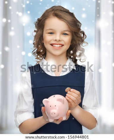 banking, finances, investment and happy people concept - beautiful girl with piggy bank
