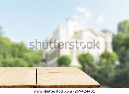 Banking. Real estate sale, home savings, loans market concept. Housing industry mortgage plan and residential tax saving strategy. Piggy bank isolated outside home on background. Focus on piggybank - stock photo