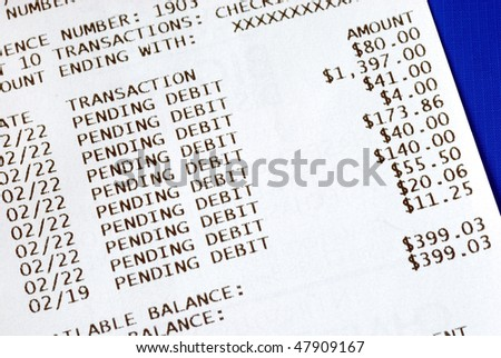 Banking slip after an ATM transaction isolated on blue - stock photo