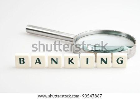 Banking word and magnifying glass